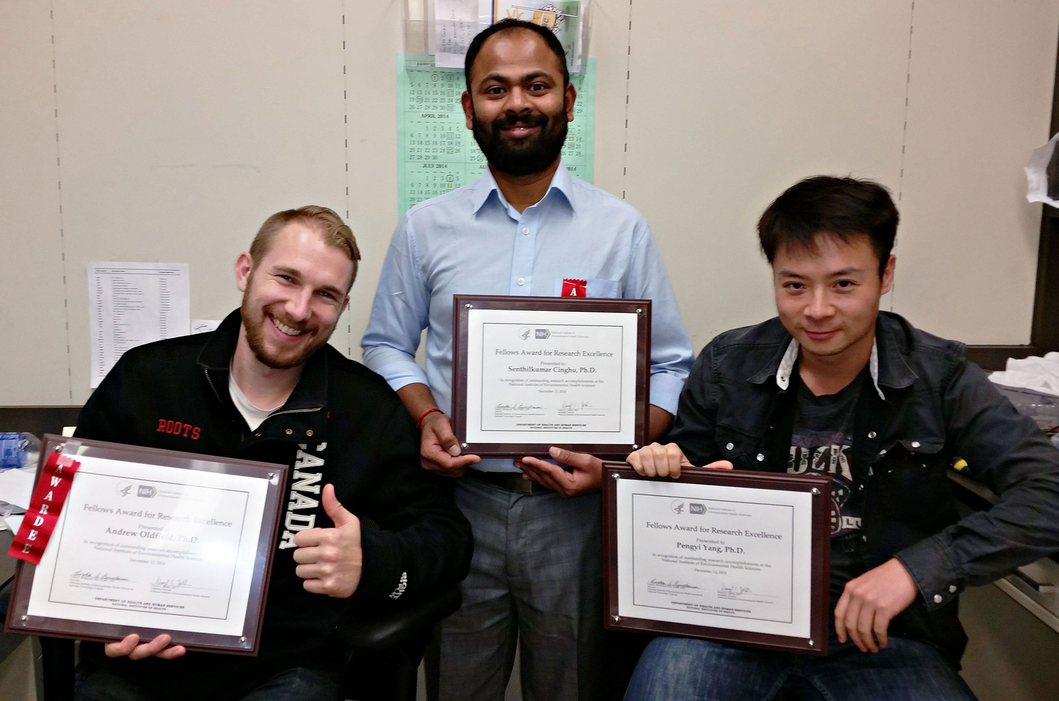 Andrew, Senthil, and Pengyi showing off with their NIH Fellows Award for Research Excellence. This is Senthil's second such award.